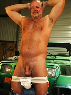 Older stallion removes his clothes in order to unveil his throbbing member