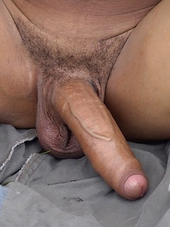 Big uncut Latin cock looks gorgeous as the solo guy jerks off in the grass
