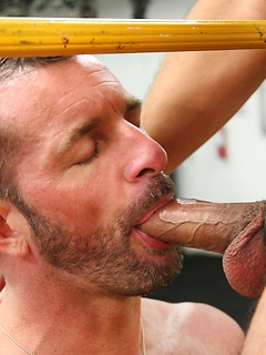 Hunks in the gym demonstrate their cock swallowing expertise