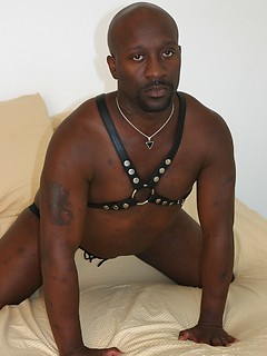 Solo black guy likes to jerk his stiff pecker until he cums on himself