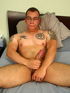 Bespectacled and inked Army stallion gets to stroke his massive meat pole