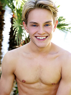 Super hot young blonde gay model Jett Black strips and smiles outdoors