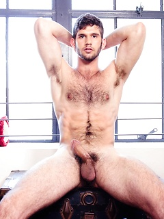 Hairy chest solo hottie poses for your pleasure and beats off while playing with his ass