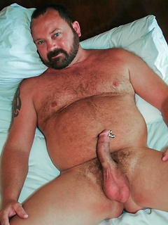 Cute blue eyed bear with a PA piercing whips it out and strokes his dick