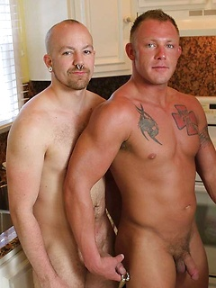 Naked gay hotties in the kitchen blow each other passionately and have bareback sex