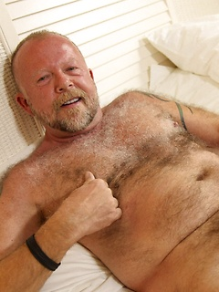 Bearded and hairy daddy bear Jim Scott strips and plays with his hard nipples