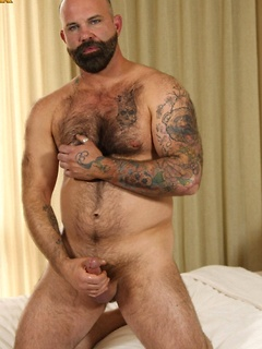 Hairy dude takes off the clothes so he can play with his big stiff dick