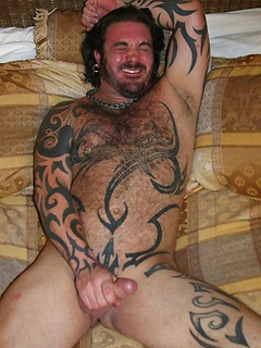 Muscular and hairy bear Rock Ramsey makes his fat dick explode with sticky cum