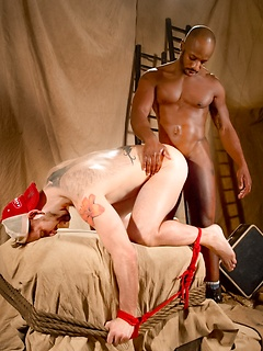 Black dom shoves his big cock up the ass of his white submissive boy