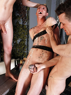 Chained and bound twink endures the pain of hot wax torture on his body