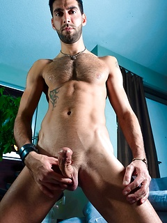 Solo gay model with a beard and a beautiful cock strips out of his tight blue jeans