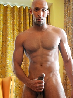 Muscular ebony guy Ramsees flashes his abs and gorgeous cock for us