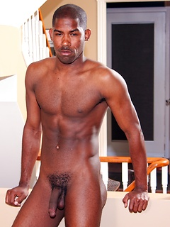 Black hunk Scottie grabs hold of his dark dick and gives it a few sexy strokes