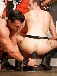 Its time for ass stretching as the gay sub in the dungeon takes a huge toy in his butt