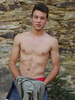 Hot abs and a great ass on the young man stripping and flaunting his body outdoors