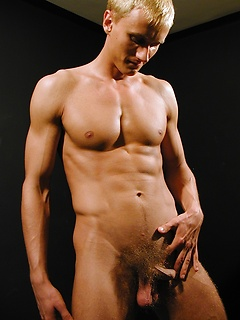 Strong dude slowly takes off the clothes and shows off his hairy pecker