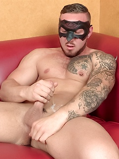 Horny guy with a mask likes to jerk his stiff pecker until he cums on himself