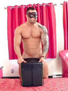 Masked and muscular solo hunk plays with sex toys and busts a nut in a hotel room