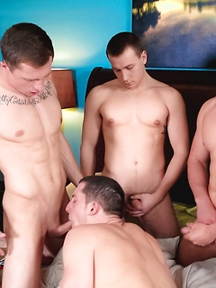 Four handsome and hung guys get around to fucking like crazy in the bedroom