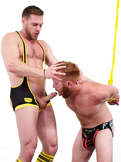 Bound and bearded gay redhead opens his mouth for the cock of his master
