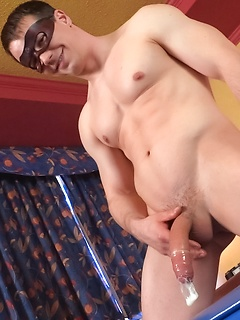 Masked and hunky model cums in a condom and the director drinks the semen
