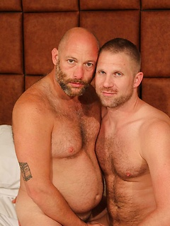 Daddy bear in bed gets his dick sucked by a passionate pair of lips