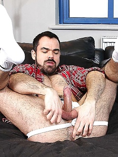 Dolan Wolf sticks a rather large dildo in his butthole while tugging on his rod