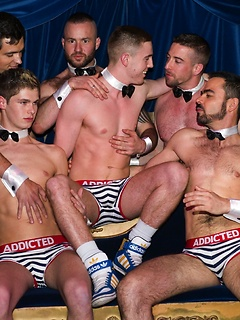 Group of gay guys likes to wear tight underwear while they dance at the party