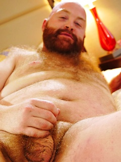 Hairy ginger bear strips down completely before making his shaft explode
