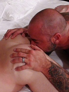 Daddy bear with a grey beard pushes his bareback cock into a sexy cub ass
