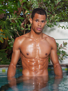 Hot black guy Brandon Foster has a flawless six pack and he flashes those abs poolside