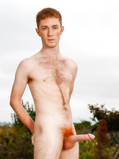 Skinny redhead shows off his hairy chest and big cock with a fire crotch