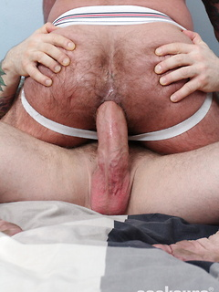Big bareback cock of a burly bear dude fucks the hairy asshole and cums