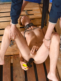 Collared and chained twink sub Skyler Dallon takes a huge toy up his asshole