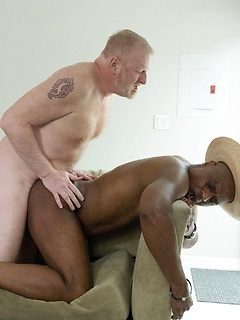 Black guy starts slurping on a long pecker before he gets his tight ass banged