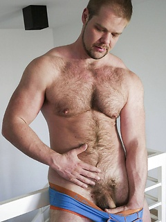 Handsome guy slowly strips down before he starts playing with his cock