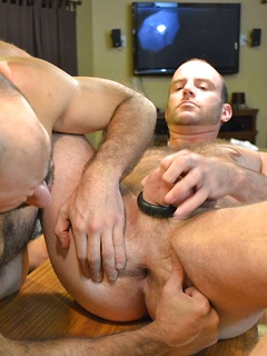 Daddies in the kitchen get each other hot and bothered with their mouths and fuck lustily