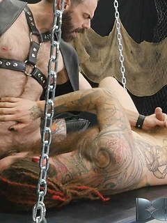 Two rather horny and inked dudes get to have some naughty fun in the dungeon