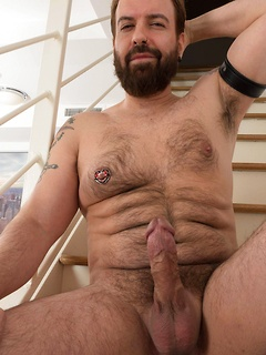Solo bear with a thick body and nipple ring makes his dick nice and hard for you