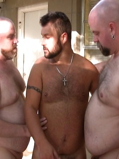 Tattooed gay dude has to moan loudly while two friends fuck his tight butt
