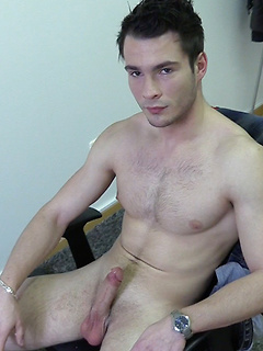 Ripped brown-haired guy tugs on his long shaft and cums in another dude's hand